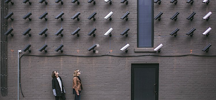 building with cameras on wall - Commercial Security For Business - Holder's