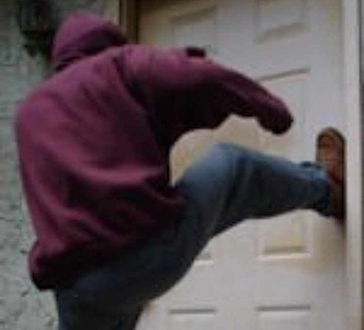 photo of man kicking in door – Upgrade the security of your exterior doors - Holder's Total Security, Tulsa, Oklahoma